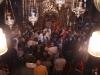 نيافة متروبوليت كابيتوليا ايسيخوس وهو يسلم الإسرار المقدسة